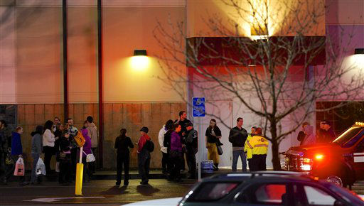 Shoppers wait to be evacuated outside the scene of a multiple shooting at Clackamas Town Center Mall in Clackamas, Ore., Tuesday Dec. 11, 2012. A gunman is dead after opening fire in the Portland, Ore., area shopping mall Tuesday, killing two people and wounding another, sheriff&#39;s deputies said. &#40;AP Photo&#47;Greg Wahl-Stephens&#41; <span class=meta>(AP Photo&#47; Greg Wahl-Stephens)</span>