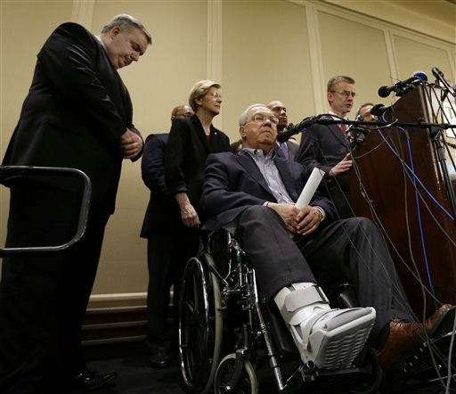Boston Mayor Thomas Menino, below, sits in a wheelchair as he and Boston Police Commissioner Ed Davis, far left, listen to FBI Special Agent in Charge Richard DesLauriers, far right, speak during a news conference in Boston Tuesday, April 16, 2013 regarding two bombs which exploded in the street near the finish line of the Boston Marathon on Monday, killing at least three people and injuring more than 140. &#40;AP Photo&#47;Elise Amendola&#41; <span class=meta>(AP Photo&#47; Elise Amendola)</span>