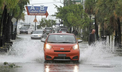 A car goes through a flooded street due to heavy rains in Key West, Fla., Sunday, Aug. 26, 2012 as heavy winds and rain hit the northern coast. Rain bands from Tropical Storm Isaac are expected to continue streaming across Marion County Monday as the ninth named storm of the 2012 hurricane season continues toward the northern Gulf of Mexico. National Weather Service officials in Jacksonville on Sunday said Marion County began getting rain bands from Isaac around 2 p.m. and that the rain would continue through Tuesday. &#40;AP Photo&#47;Alan Diaz&#41; <span class=meta>(AP Photo&#47; Alan Diaz)</span>