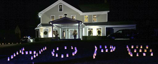"<div class=""meta image-caption""><div class=""origin-logo origin-image ""><span></span></div><span class=""caption-text"">The word ""HOPE"" is illuminated on the front lawn of a funeral home hosting the wake of Sandy Hook Elementary School principal Dawn Lafferty Hochsprung in Woodbury, Conn., Wednesday, Dec. 19, 2012. A gunman opened fire killing 26 people, including the principal and 20 children, at the school in Newtown before killing himself on Dec. 14. (AP Photo/Charles Krupa) (AP Photo/ Charles Krupa)</span></div>"