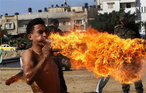 A members of Hamas&#39; Palestinian National Security personnel blows fire during a graduation ceremony in Gaza City, Sunday, Dec. 2, 2012.   Israel has rejected the borders of a future Palestinian state the U.N. endorsed last week and on Friday, Israel announced it would press ahead plans to build thousands of settler homes. And it is punishing the Palestinians further by withholding more than &#36;100 million in taxes and other funds collected on their behalf. &#40;AP Photo&#47;Hatem Moussa&#41; <span class=meta>(AP Photo&#47; Hatem Moussa)</span>