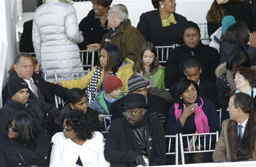 Entertainer will.i.am, front center, waits in the presidential box for President Barack Obama to walk along the parade route on Pennsylvania Avenue en route to the White House, Monday, Jan. 21, 2013, in Washington. Thousands marched during the 57th Presidential Inauguration parade after the president&#39;s ceremonial swearing-in. &#40;AP Photo&#47;Gerald Herbert&#41; <span class=meta>(AP Photo&#47; Gerald Herbert)</span>