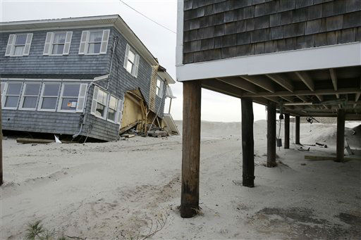 A raised home with modest damage is seen next to a severely damaged beach front home in Mantoloking, N.J., Friday, Feb. 22, 2013. One of the hardest-hit Jersey shore communities, Mantoloking, will allow its residents to begin moving back home Friday. It is the last shore town to do so. It&#39;s not a mad rush. The winter population of the barrier island community totals only about 100 and many homes are not yet livable. &#40;AP Photo&#47;Mel Evans&#41; <span class=meta>(AP Photo&#47; Mel Evans)</span>