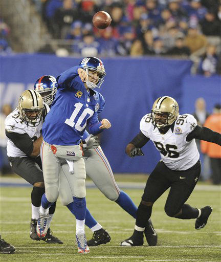 "<div class=""meta ""><span class=""caption-text "">New York Giants quarterback Eli Manning (10) throws a pass as New Orleans Saints Tom Johnson (96) rushes the passer during the second half of an NFL football game Sunday, Dec. 9, 2012, in East Rutherford, N.J. (AP Photo/Bill Kostroun) (AP Photo/ Bill Kostroun)</span></div>"