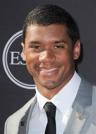 "<div class=""meta ""><span class=""caption-text "">NFL player Russell Wilson arrives at the ESPY Awards on Wednesday, July 17, 2013, at Nokia Theater in Los Angeles. (Photo by Jordan Strauss/Invision/AP) (Photo/Jordan Strauss)</span></div>"