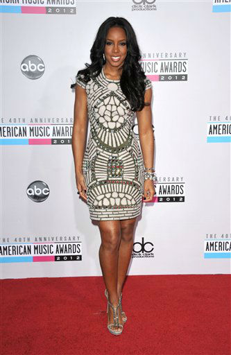 "<div class=""meta image-caption""><div class=""origin-logo origin-image ""><span></span></div><span class=""caption-text"">Kelly Rowland arrives at the 40th Anniversary American Music Awards on Sunday, Nov. 18, 2012, in Los Angeles. (Photo by John Shearer/Invision/AP) (AP Photo/ John Shearer)</span></div>"
