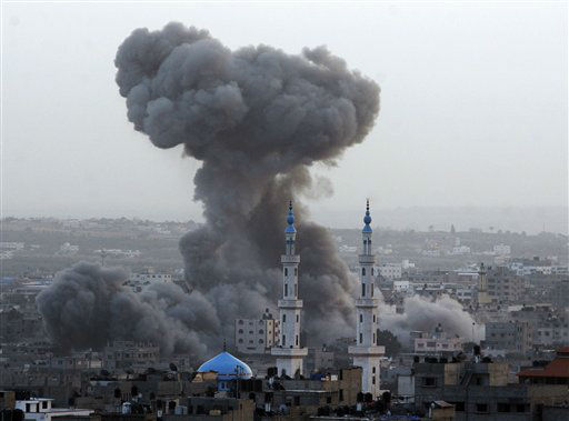 "<div class=""meta ""><span class=""caption-text "">Smoke rises after an Israeli forces strike in Gaza City, Saturday, Nov. 17, 2012. Israel bombarded the Hamas-ruled Gaza Strip with nearly 200 airstrikes early Saturday, the military said, widening a blistering assault on Gaza rocket operations by militants to include the prime minister's headquarters, a police compound and a vast network of smuggling tunnels. (AP Photo/Hatem Moussa) (AP Photo/ Hatem Moussa)</span></div>"