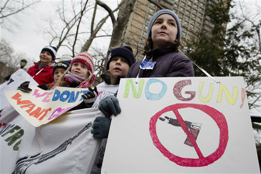 "<div class=""meta ""><span class=""caption-text "">Nico Rasinski, 9, Bronxville, holds a sign that reads ""No Guns!"" in Cadmen Park before the One Million Moms for Gun Control Rally march over the Brooklyn bridge, Jan. 21, 2012, in the Brooklyn borough of New York. Demonstrators called for new gun control legislation, demanding a ban on assault weapons and stricter regulations on gun purchases. (AP Photo/John Minchillo) (AP Photo/ John Minchillo)</span></div>"