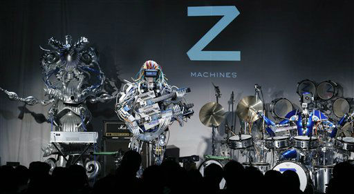 Robot music band Z-Machines members, guitarist robot Mach, center,  keyboard player robot Cosmo, left, and drummer robot Ashura, perform during their first live event in Tokyo Monday, June 24, 2013. Supervised by Japanese artists and creators, Z-Machines has been developed to realize the cutting edge party scene by featuring the guitarist robot with 78 fingers and 12 picks, the drummer robot with 21 sticks and the keyboard robot that can flash multi-layered beams from its eyes, enabling transcendental music performance. &#40;AP Photo&#47;Koji Sasahara&#41; <span class=meta>(AP Photo&#47; Koji Sasahara)</span>
