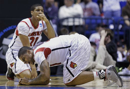 Louisville&#39;s Chane Behanan, foreground, and Wayne Blackshear &#40;20&#41; react to guard Kevin Ware&#39;s injury during the first half of the Midwest Regional final against Duke in the NCAA college basketball tournament, Sunday, March 31, 2013, in Indianapolis. &#40;AP Photo&#47;Michael Conroy&#41; <span class=meta>(AP Photo&#47; Michael Conroy)</span>