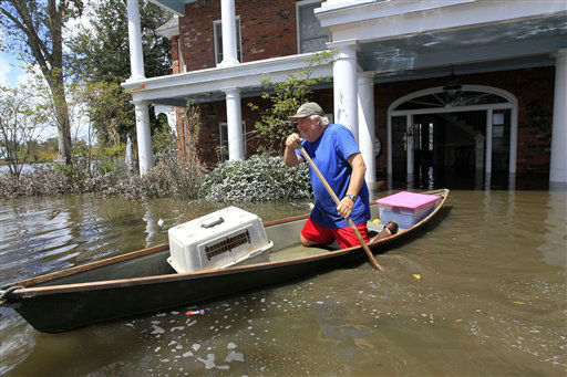 Don Duplantier paddles a pirogue from his flooded home as floodwaters from Hurricane Isaac recede in Braithwaite, La., Sunday, Sept. 2, 2012. Duplantier had retrieved his cat and had collected his daughter&#39;s bridesmaid dress for the upcoming wedding of his son. &#40;AP Photo&#47;Gerald Herbert&#41; <span class=meta>(AP Photo&#47; Gerald Herbert)</span>