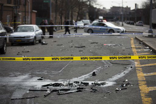 "<div class=""meta ""><span class=""caption-text "">Debris from a fatal accident that claimed the lives of two expectant parents litter Kent Avenue, Sunday, March 3, 2013, in the Brooklyn borough of New York. A driver struck the car the couple were riding in early Sunday morning, killing both parents while their baby, who?was born prematurely, survived?and is?in critical condition. (AP Photo/John Minchillo) (AP Photo/ John Minchillo)</span></div>"