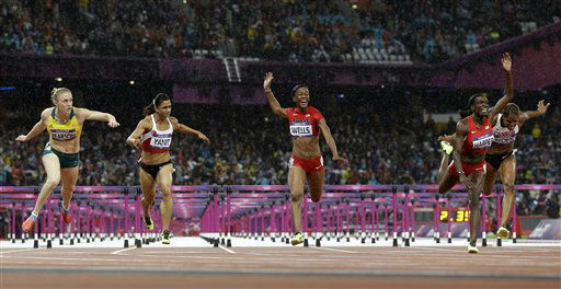 "<div class=""meta ""><span class=""caption-text "">Australia's Sally Pearson, left, crosses the finish line to win the gold in the women's 100-meter hurdles final during the athletics in the Olympic Stadium at the 2012 Summer Olympics, London, Tuesday, Aug. 7, 2012.(AP Photo/Anja Niedringhaus) (AP Photo/ Anja Niedringhaus)</span></div>"