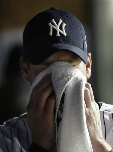 New York Yankees relief pitcher Derek Lowe wipes his face after leaving the game in the eighth inning during Game 1 of the American League championship series against the Detroit Tigers Saturday, Oct. 13, 2012, in New York. &#40;AP Photo&#47;Paul Sancya &#41; <span class=meta>(AP Photo&#47; Paul Sancya)</span>