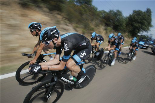 Britain&#39;s Christopher Froome, front, rides with his teammates during a training in Porto Vecchio, southern Corsica island, France, Thursday June 27, 2013. The race starts in Porto Vecchio on Saturday June 29, and the 198-rider peloton, or pack, is to cover 3,479 kilometers &#40;2,162 miles&#41; over three weeks, 21 stages and two rest days, before an unusual nighttime finish July 21 on the Champs-Elysees in Paris. &#40;AP Photo&#47;Christophe Ena&#41; <span class=meta>(AP Photo&#47; Christophe Ena)</span>