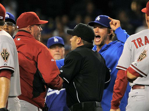 Los Angeles Dodgers starting pitcher Clayton Kershaw, right, yells as Arizona Diamondbacks manager Kirk Gibson, left, as umpire Clint Fagan separates them after Los Angeles Dodgers&#39; Zack Greinke was hit by a pitch during the seventh inning of their baseball game, Tuesday, June 11, 2013, in Los Angeles.  &#40;AP Photo&#47;Mark J. Terrill&#41; <span class=meta>(AP Photo&#47; Mark J. Terrill)</span>