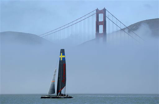 An AC45 catamaran from Artemis Racing of Sweden makes its way past fog and the Golden Gate Bridge during training for the America&#39;s Cup on Wednesday, June 26, 2013, in San Francisco. Opening ceremonies for the sailing event are on July 4. Artemis is training on its smaller AC45 boats until its larger AC72 is ready in late July. &#40;AP Photo&#47;Eric Risberg&#41; <span class=meta>(AP Photo&#47; Eric Risberg)</span>