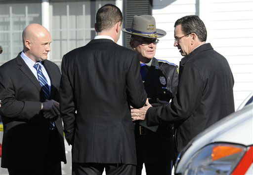 "<div class=""meta ""><span class=""caption-text "">Gov. Dannel P. Malloy, right, talks with officials at a staging area following a shooting at the Sandy Hook Elementary School in Newtown, Conn., about 60 miles (96 kilometers) northeast of New York City, Friday, Dec. 14, 2012. An official with knowledge of Friday's shooting said 27 people were dead, including 18 children. (AP Photo/Jessica Hill) (AP Photo/ Jessica Hill)</span></div>"