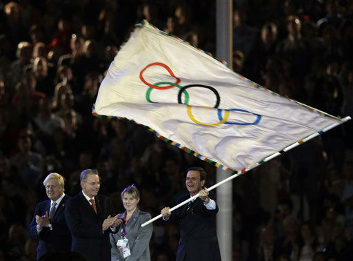 Rio de Janeiro mayor Eduardo Paes waves the olympic flag next to Jacques Rogge and London Mayor Boris Johnson, left, during the Closing Ceremony at the 2012 Summer Olympics, Sunday, Aug. 12, 2012, in London. &#40;AP Photo&#47;Charlie Riedel&#41; <span class=meta>(AP Photo&#47; Charlie Riedel)</span>