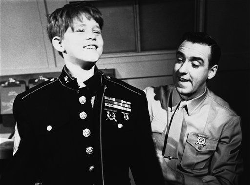 Ronny Howard, left, who has run away from his home in Mayberry to join the U.S. Marines, shows Jim Nabors how he looks in a sergeant&#39;s dress uniform on &#34;Gomer Pyle - USMC,&#34; March 18, 1966. &#40;AP Photo&#41; <span class=meta>(AP Photo&#47; Anonymous)</span>
