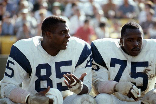 Los Angeles Rams defensive end Lamar Lundy &#40;85&#41; and Deacon Jones &#40;75&#41; talk on the bench during an NFL game against the Baltimore Colts at the Los Angeles Coliseum, Oct. 30, 1966. The Colts defeated the Rams, 17-3.   &#40;AP Photo&#47;NFL Photos&#41; <span class=meta>(AP Photo&#47; Uncredited)</span>