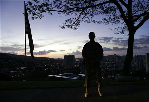 A Marine stands post at dawn prior to the Memorial Service for Sen. Daniel Inouye, D-Hawaii, at the Punchbowl National Memorial Cemetery of the Pacific in Honolulu, Sunday, Dec. 23, 2012. &#40;AP Photo&#47;Gerald Herbert&#41; <span class=meta>(AP Photo&#47; Gerald Herbert)</span>