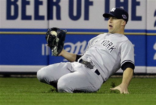 New York Yankees&#39; Brett Gardner makes a catch on a ball hit by Detroit Tigers&#39; Jhonny Peralta in the eighth inning during Game 3 of the American League championship series Tuesday, Oct. 16, 2012, in Detroit. &#40;AP Photo&#47;Paul Sancya &#41; <span class=meta>(AP Photo&#47; Paul Sancya)</span>