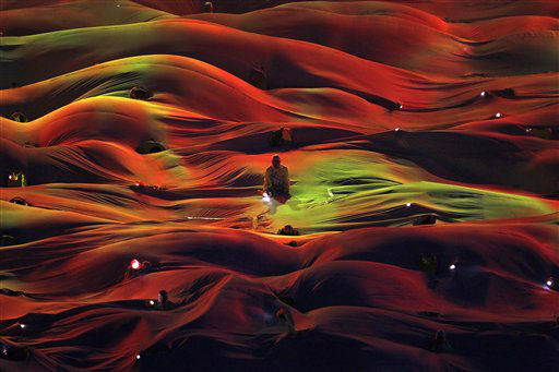 A performer is silhouetted in a sea of cloth during a national celebration on Thursday Aug. 9, 2012 in Singapore which celebrated its 47th year of independence. Singapore declared independent on August 9, 1965. &#40;AP Photo&#47;Wong Maye-E&#41; <span class=meta>(AP Photo&#47; Wong Maye-E)</span>