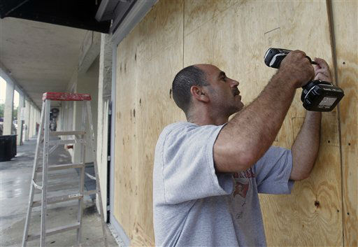 Oren Eshel boards a storefront on Duval Street in Key West, Fla., Saturday, Aug. 25, 2012 in preparation for Tropical Storm Isaac, Saturday, Aug. 25, 2012. Isaac&#39;s winds are expected to be felt in the Florida Keys by sunrise Sunday morning. &#40;AP Photo&#47;Alan Diaz&#41; <span class=meta>(AP Photo&#47; Alan Diaz)</span>