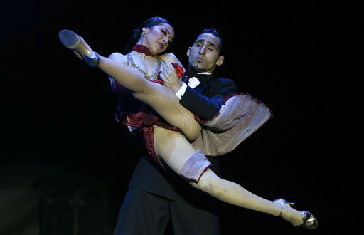 Argentina&#39;s dancers Ariel Leguizamon and Yesica Esquivel, top, compete during the 2012 Tango Dance World Cup stage finals in Buenos Aires, Argentina, Tuesday, Aug. 28, 2012. Couples from around the world competed in the finals Argentina&#39;s annual tango competition, the highlight of a two-week festival which this year honored Astor Piazzolla, the legendary composer and bandoneonista who revived the genre and infuriated purists by blending tango with rock music in the 1970s. &#40;AP Photo&#47;Natacha Pisarenko&#41; <span class=meta>(AP Photo&#47; Natacha Pisarenko)</span>