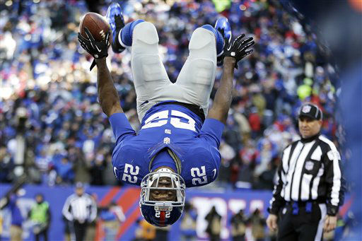 New York Giants running back David Wilson &#40;22&#41; flips while celebrating a touchdown during the first half of an NFL football game against the Philadelphia Eagles, Sunday, Dec. 30, 2012, in East Rutherford, N.J. &#40;AP Photo&#47;Kathy Willens&#41; <span class=meta>(AP Photo&#47; Kathy Willens)</span>