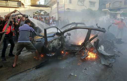 "<div class=""meta ""><span class=""caption-text "">People gather around a wreckage of the car in which was killed Ahmed Jabari, head of the Hamas military wing in Gaza City, Wednesday, Nov. 14, 2012. The Israeli military said its assassination of the Hamas military commander marks the beginning of an operation against Gaza militants. (AP Photo/Adel Hana) (AP Photo/ Adel Hana)</span></div>"