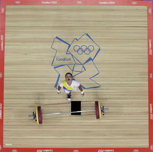 Colombia&#39;s Rusmeris Villar Barbosa reacts during the women&#39;s 53-kg, group A, weightlifting competition at the 2012 Summer Olympics, Sunday, July 29, 2012, in London. &#40;AP Photo&#47;Ng Han Guan&#41; <span class=meta>(AP Photo&#47; Ng Han Guan)</span>