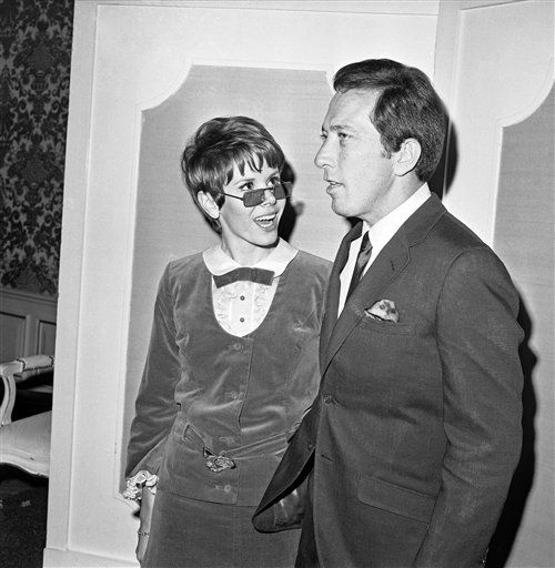 "<div class=""meta ""><span class=""caption-text "">Looking over her granny glasses, Judy Carne, co-star of ABC-TV?s ?Love on a Rooftop,? talks with Andy Williams at the TV awards nomination party of the Hollywood Foreign Press Association in Hollywood, Los Angeles on Jan. 27, 1967. Andy will host the awards banquet on February 15. It will be telecast live. (AP Photo/David Smith) (AP Photo/ David Smith)</span></div>"