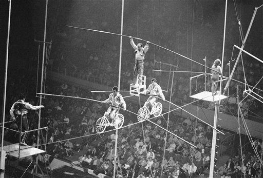 Karl Wallenda, 62, on chair, of the famed ?Flying Wallendas,? who quit act last fall, was back with the group as they performed in the Dobritch International Circus in Los Angeles on March 17, 1967. Karl, 40-year veteran of the circus, says he will retire after the present engagement. &#40;AP Photo&#47;Harold P. Matosian&#41; <span class=meta>(AP Photo&#47; Harold P. Matosian)</span>