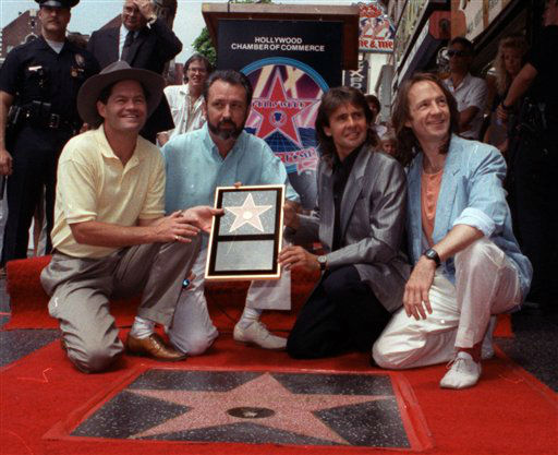 In this July 10, 1989 file photo, The Monkees, from left: Micky Dolenz, Mike Nesmith, Davy Jones and Peter Tork  get a star on the Hollywood Walk of Fame. &#40;AP Photo&#47;Mark Terrill&#41; <span class=meta>(AP Photo&#47; Mark Terrill)</span>