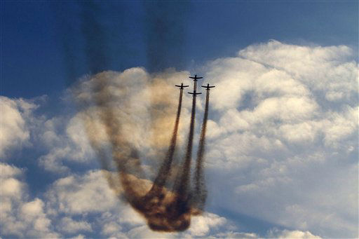 Israeli Air Force planes fly during an acrobatics display during a graduation ceremony in the Hatzerim air force base near the southern city of Beersheba, Israel, Thursday, Dec. 27, 2012. &#40;AP Photo&#47;Ariel Schalit&#41; <span class=meta>(AP Photo&#47; Ariel Schalit)</span>