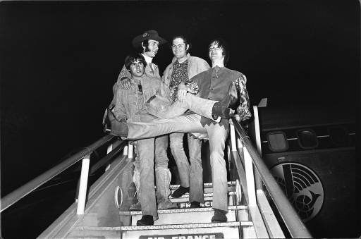 American pop group, the Monkees, pictured on arrival at London Airport, 28th June, 1967. Arriving from Paris, the group will perform a live stage show at the Empire Pool, Wembley, this coming weekend. Left to right are Davy Jones, Peter Tork, Micky Dolenz and Mike Nezsmith. &#40;AP photo&#41;. <span class=meta>(AP Photo&#47; MGF)</span>