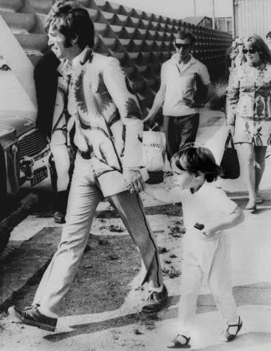 "<div class=""meta ""><span class=""caption-text "">Beatle John Lennon and his son Julian are pictured at Heathrow Airport London, July 22, 1967, before boarding a plane for a holiday trip to Athens, Greece. His wife, Cynthia, were also in the party.  (AP Photo) (AP Photo/ XDK BTD)</span></div>"