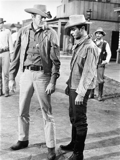 In this 1967 file photo originally released by CBS, actor James Arness, portraying Marshal Matt Dillon, left, is shown  with Richard Evans, in a scene from &#34;Gunsmoke.&#34; CBS spokesman Chris Ender says Arness died Friday, June 3, 2011 of natural causes. He was 88. &#40;AP Photo&#47;CBS-TV, file&#41; NO SALES, NORTH AMERICA USE ONLY <span class=meta>(AP Photo&#47; Anonymous)</span>