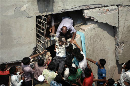"<div class=""meta image-caption""><div class=""origin-logo origin-image ""><span></span></div><span class=""caption-text"">A man who was trapped in an eight-story building housing several garment factories is rescued after the structure collapsed in Savar, near Dhaka, Bangladesh, Wednesday, April 24, 2013. The building collapsed near Bangladesh's capital Wednesday morning, killing dozens of people and trapping many more in the rubble, officials said. (AP Photo/ A.M. Ahad) (AP Photo/ A.M. Ahad)</span></div>"