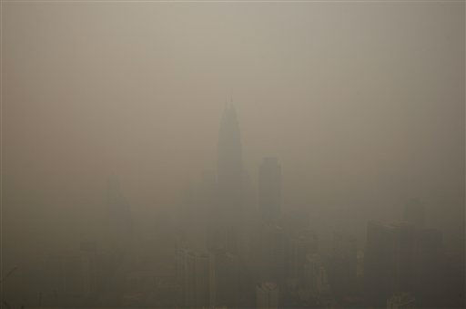 Skylines are covered under thick haze in Kuala Lumpur, Malaysia, Monday, June 24, 2013. Malaysian authorities declared a state of emergency Sunday in a southern district where a smoky haze blamed on Indonesian forest fires has triggered one of the country&#39;s worst pollution levels in years. &#40;AP Photo&#47;Lai Seng Sin&#41; <span class=meta>(AP Photo&#47; Lai Seng Sin)</span>