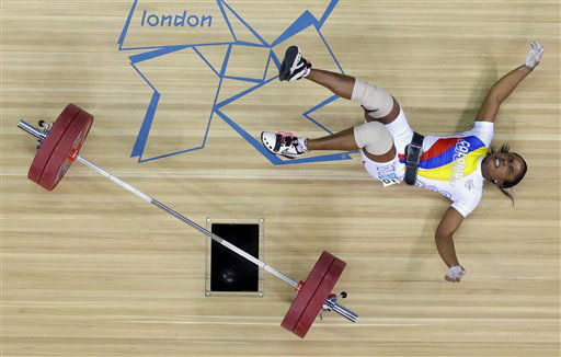Lina Marcela Rivas of Colombia falls while competing during the women&#39;s 58-kg weightlifting competition at the 2012 Summer Olympics, Monday, July 30, 2012, in London. &#40;AP Photo&#47;Ben Curtis&#41; <span class=meta>(AP Photo&#47; Ben Curtis)</span>