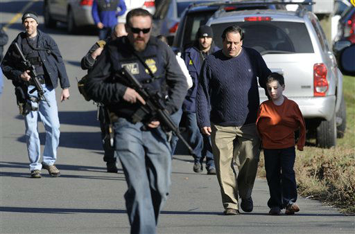 Parents leave a staging area after being reunited with their children following a shooting at the Sandy Hook Elementary School in Newtown, Conn. where authorities say a gunman opened fire, leaving 27 people dead, including 20 children, Friday, Dec. 14, 2012. &#40;AP Photo&#47;Jessica Hill&#41; <span class=meta>(AP Photo&#47; Jessica Hill)</span>