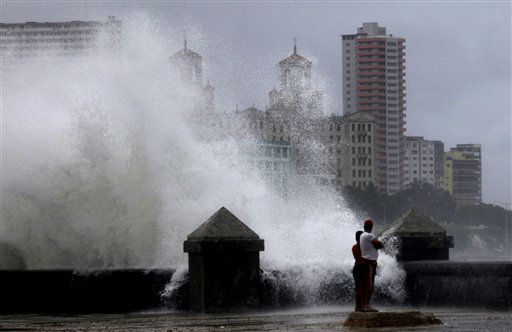 "<div class=""meta ""><span class=""caption-text "">Waves pound the boardwalk, the Malecon, during the passing of Tropical Storm Isaac in Havana Cuba, Sunday, Aug. 26, 2012. The hurricane center said the storm, which was swirling north of the central coast of Cuba in the pre-dawn hours, was expected to be near or over the Florida Keys sometime later Sunday or Sunday night. (AP Photo/Ramon Espinosa) (AP Photo/ Ramon Espinosa)</span></div>"