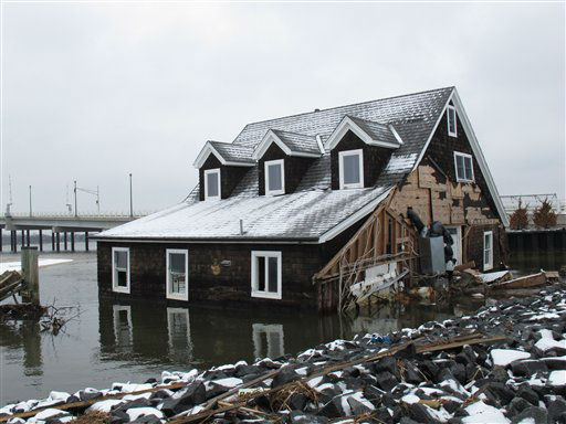 This home in Mantoloking N.J., shown on Feb. 5, 2013, is one of 58 that washed into the Barnegat Bay in just this one Jersey shore town during Superstorm Sandy. Mantoloking, one of the hardest-hit Jersey shore communities, will allow its residents to begin moving back home on Feb. 22, 2013. It is the last shore town to do so. &#40;AP Photo&#47;Wayne Parry&#41; <span class=meta>(AP Photo&#47; Wayne Parry)</span>