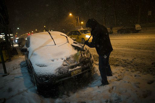 "<div class=""meta ""><span class=""caption-text "">A motorist clears snow from his car on 59th Street, Friday, Feb. 8, 2013, in New York. Snow began falling across the Northeast on Friday, ushering in what was predicted to be a huge, possibly historic blizzard and sending residents scurrying to stock up on food and gas up their cars. (AP Photo/John Minchillo) (AP Photo/ John Minchillo)</span></div>"