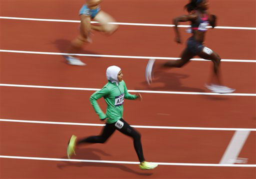 Saudi Arabia&#39;s Sarah Attar competes in a women&#39;s 800-meter heat during the athletics in the Olympic Stadium at the 2012 Summer Olympics, London, Wednesday, Aug. 8, 2012. &#40;AP Photo&#47;Daniel Ochoa De Olza&#41; <span class=meta>(AP Photo&#47; Daniel Ochoa De Olza)</span>