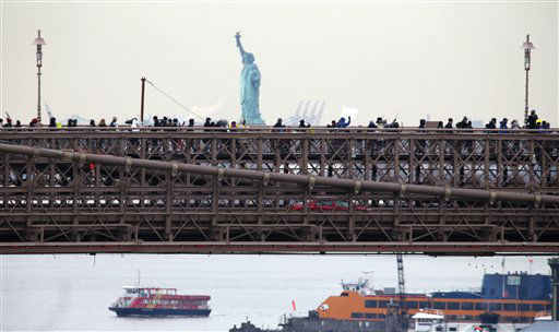 People organized by a gun control group formed in the wake of last month&#39;s massacre at a Connecticut elementary school march across the Brooklyn Bridge on Monday, Jan. 21, 2013, in New York. Organizers One Million Moms for Gun Control wants Congress to follow New York&#39;s lead and enact stricter limits on weapons and ammunition purchases. &#40;AP Photo&#47;Peter Morgan&#41; <span class=meta>(AP Photo&#47; Peter Morgan)</span>
