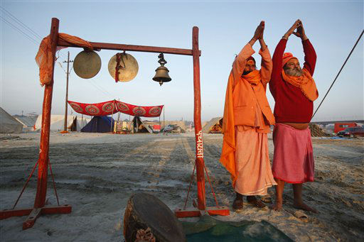 Hindu holy men who have arrived ahead of the month-long Mahakumbh festival perform morning rituals &#34;Sangam,&#34; the confluence of rivers Ganges and Yamuna in Allahabad, India, Wednesday, Dec. 19, 2012.  Millions of Hindu pilgrims are expected to arrive here in January for the religious congregation which takes place once in twelve years. &#40;AP Photo&#47;Rajesh Kumar Singh&#41; <span class=meta>(AP Photo&#47; Rajesh Kumar Singh)</span>